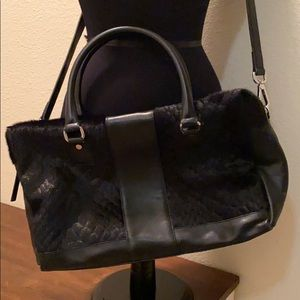 100% Leather Bag, made in Italy.